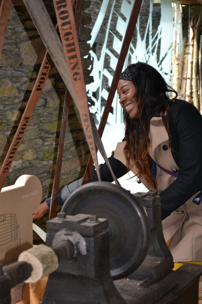 Jade tries out the bobbin lathe interactive