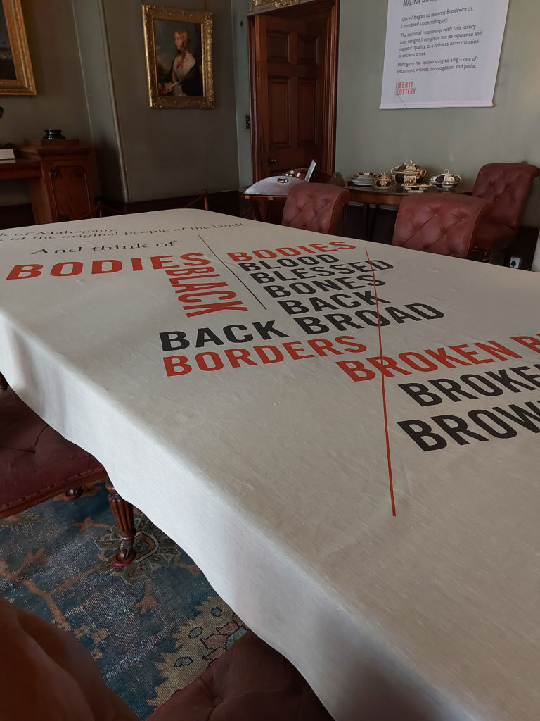 Printed to natural linen, the typographic tablecloth in the Dining Room makes a bold statement